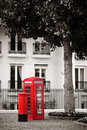 Telephone booth and mail box red in street in london as the famous icons Stock Images