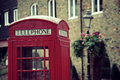 Telephone booth and mail box red in street in london as the famous icons Royalty Free Stock Photo