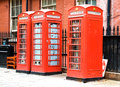 Telephone booth three red booths in london Stock Photos