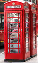 Telephone booth two red booths with bus in background Stock Image
