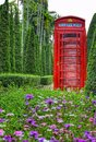 Telephone box garden flowers trees old colors Stock Photography