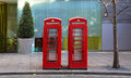 Telephone boxes two booths in central london Royalty Free Stock Images