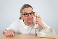 Telephone call crazy man with old Stock Images