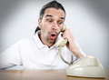 Telephone call man with old is amazed Stock Photography