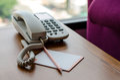Photo : Telephone On Desk  laptop