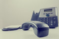 Telephone handset business with base station in the background Stock Photos