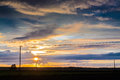 Telephone lines against sunset the old are criss crossing in the rural finland the dramatic summer creates a beautiful background Stock Image
