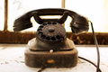 Telephone old and dust covered rotary dial Stock Photography