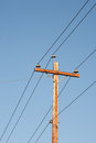 Telephone pole electrical and clear blue sky Stock Photography