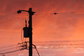 Telephone pole and wires with sunset sky Royalty Free Stock Photo