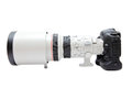 Telephoto lens on camera large white digital dslr Royalty Free Stock Photo