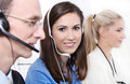 Telesales or helpdesk team - helpful woman with headset smiling Stock Photo