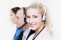 Telesales or helpdesk team helpful woman with headset smling a blonde beautiful women at camera Stock Photo