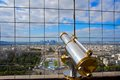 Telescope at the eiffel tower overlooking paris specifically la defense financial district Royalty Free Stock Photo