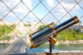 Telescope on the eiffel tower tourist top of in paris with seine in background Royalty Free Stock Images