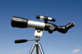 Telescope on tripod isolated blue sky concept photo of exploration and discovery Stock Photo