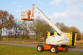 Telescopic crane an aerial platform for pruning trees with the sky as background Stock Photos