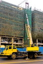 Telescopic crane are lifting heavy weight. Stock Images