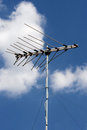 Television antenna with blue sky in thailand Stock Photos
