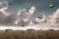 Television falling many to the sky in a meadow Stock Images