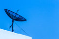 Television receiver on top of building Royalty Free Stock Image
