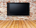 Television set on an old wall interior with a Stock Images