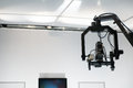 Television studio with jib camera and lights on a crane Royalty Free Stock Photography