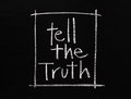 Tell the truth phrase written by hand in white chalk on a blackboard surface Royalty Free Stock Image
