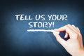 Tell us your story text on blackboard Royalty Free Stock Photo