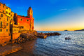 Tellaro rocks church and village on sunset cinque terre ligur old the sea houses five lands liguria italy europe Stock Photography
