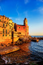 Tellaro rocks church and village on sunset cinque terre ligur old the sea houses five lands liguria italy europe Stock Photo
