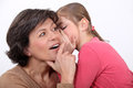 Telling her mother a secret. Royalty Free Stock Photo