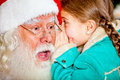 Telling Santa a secret Stock Image