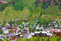Telluride town surrounded by mountain hillsides colorado beautiful at the foot of mountains on a sunny day Stock Photo