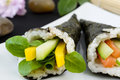 Temaki japanese hand rolled sushi one with pea shoot cucumber and peppers another with salmon cucumber chives and soft cheese Royalty Free Stock Photography