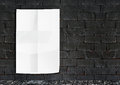 Template white crumple poster on grunge brick wall footpath g Royalty Free Stock Photo
