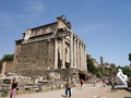 Temple of antoninus and faustina at the roman forum forum romanum in rome italy with tourists going around Stock Photo