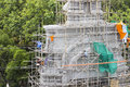 Temple entrance under construction worker on scaffold constructing in thailand Stock Image