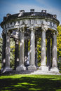 Temple, Greek-style columns, Corinthian capitals in a park Royalty Free Stock Photo