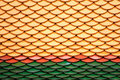 Temple roof tile yellow red green Stock Photo