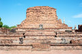 Temple ruins and damaged buddha statue at wat mahathat ayutthaya thailand june on june in is one of s most famous Stock Photo