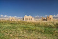 Temple ruins in kyrgyzstan of ancient on green grasslands Royalty Free Stock Photo