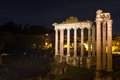 Temple of Saturn and Vespasian at night Royalty Free Stock Photo
