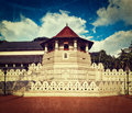 Temple of the tooth sri lanka vintage retro hipster style travel image very important buddhist shrine with grunge texture overlaid Stock Photography