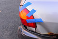 Temporary auto repair of tail light on old car with blue tape Royalty Free Stock Photo