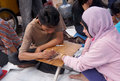 Temporary tatto people drawing tattoo on hand in the city of solo central java indonesia Stock Image