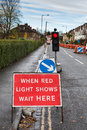 Temporary traffic lights in a street in england Stock Image