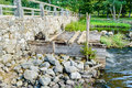 Temporary walkway a beside old stone bridge over running water Royalty Free Stock Photos