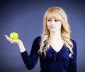 Temptation closeup portrait young thoughtful envious woman holding green fresh apple thinking looking at it having idea to eat Royalty Free Stock Images