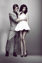 Temptation passion fashion couple in trendy clothes hugging elegance posing Stock Photo